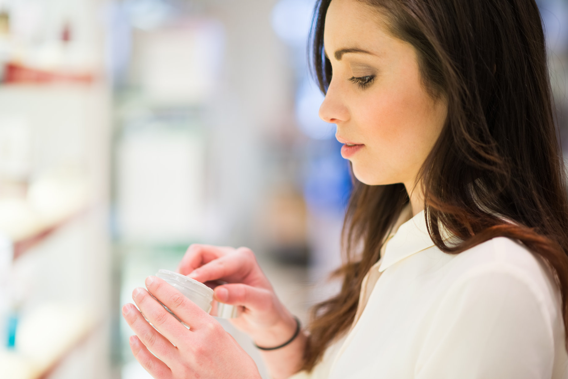 woman looking at over the counter skincare products